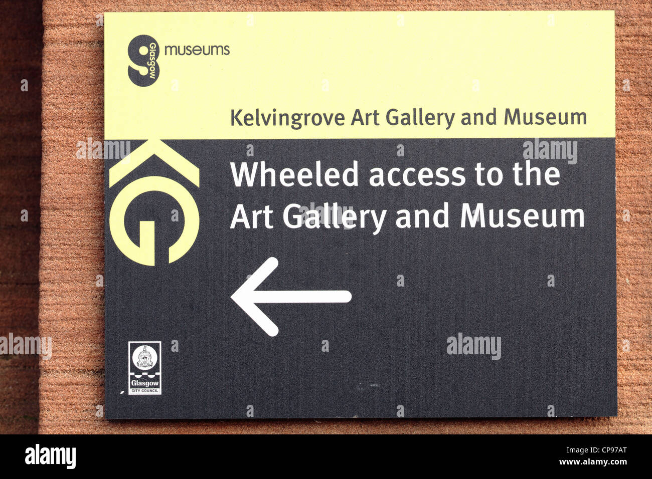Direction sign for wheeled access to Kelvingrove Art Gallery and Museum in Glasgow Scotland UK - Stock Image