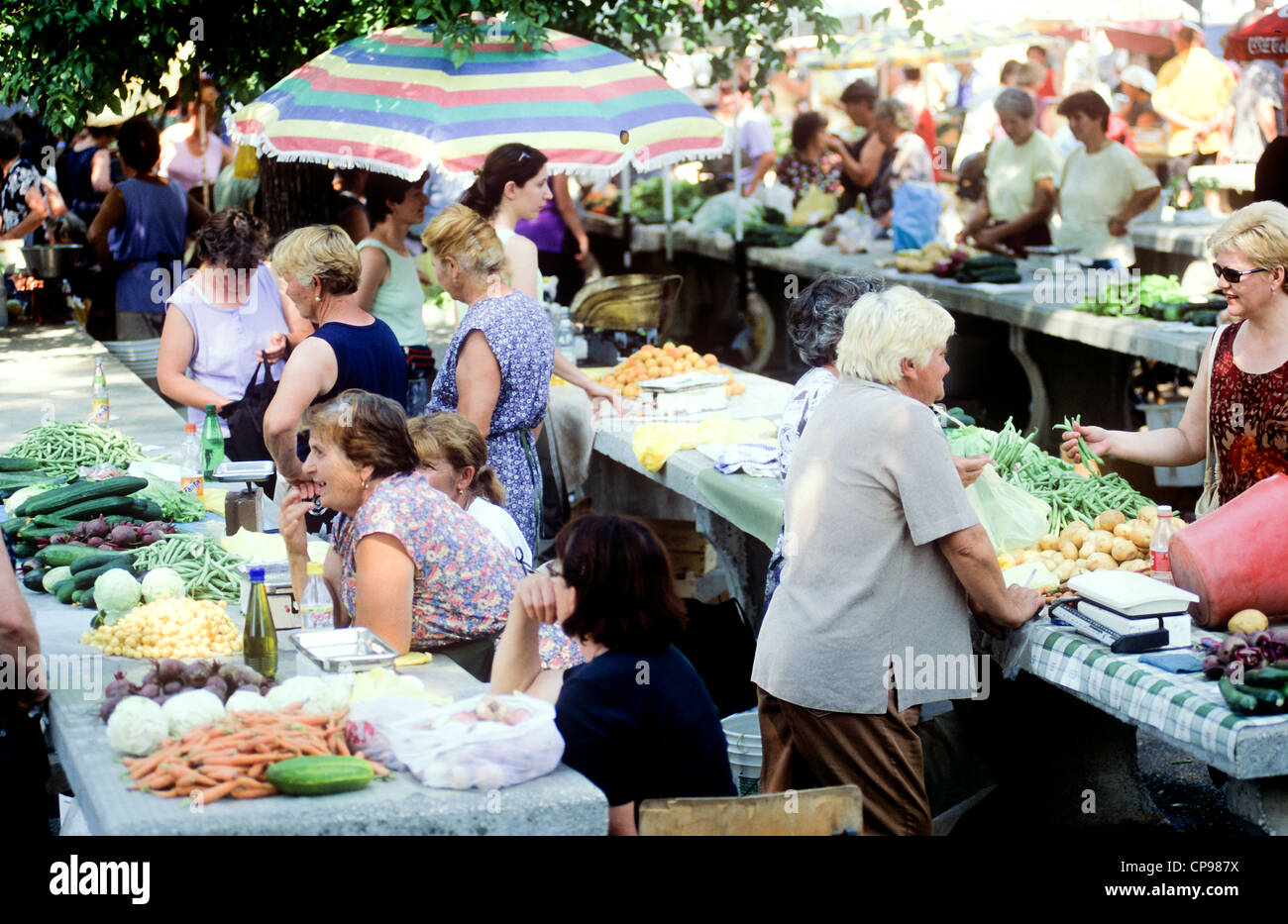 Croatian women buy and sell fruit and vegetables at local outdoor street market on Hvar Island in Dalmatia Croatia - Stock Image