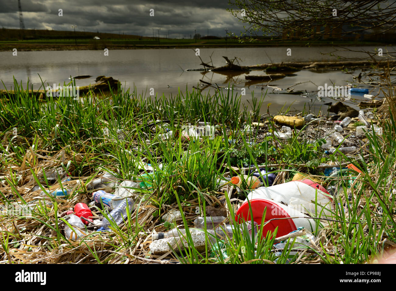waste plastic products on shore - Stock Image