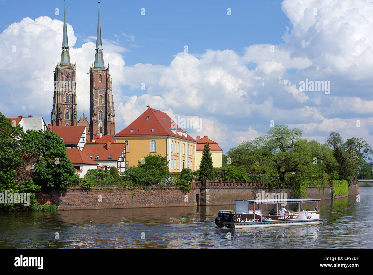 Saint John gothic cathedral Odra river Archbishop's residence in a sunny spring day Ostrow Tumski  Wroclaw Lower - Stock Image