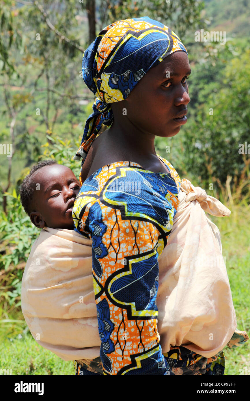 A Woman Carries Her Baby On Her Back In The Traditional