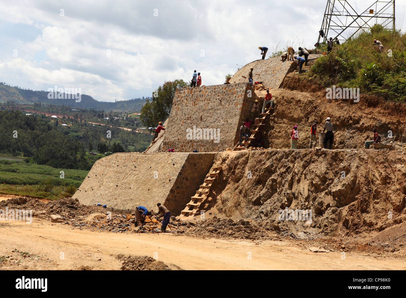 Men work constructing a highway in the Western Province of Rwanda. Stock Photo