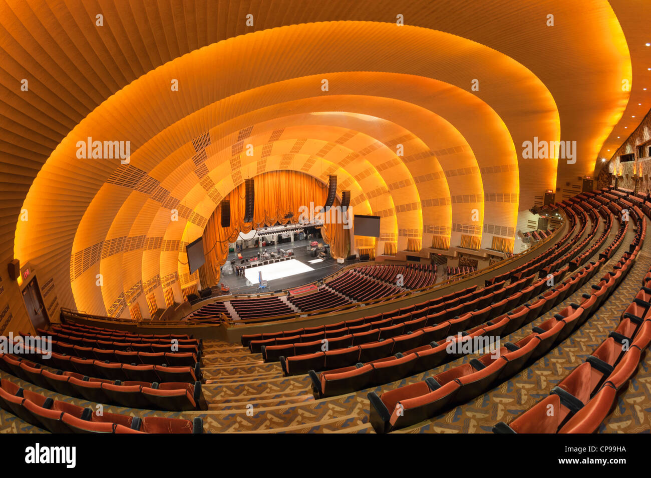 The view of the stage from the balcony as workers prepare for a show in historic Radio City Music Hall in New York - Stock Image