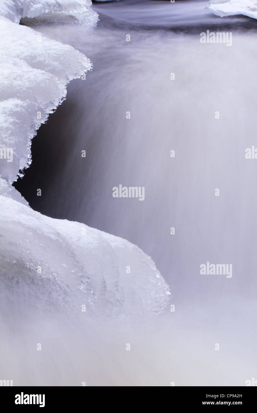 Ice and flowing water - movement Stock Photo