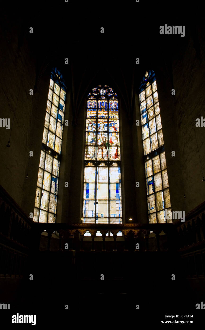 Triple stained glass window of St. Matthias' Abbey - Stock Image