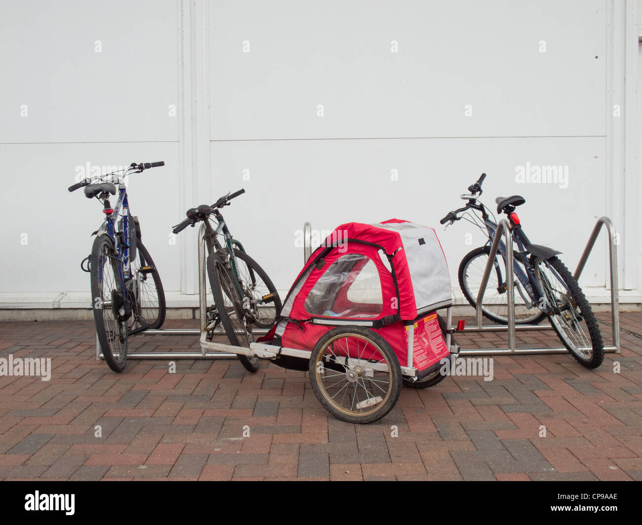 Bicycle parking with bicycles and bike trailer. - Stock Image