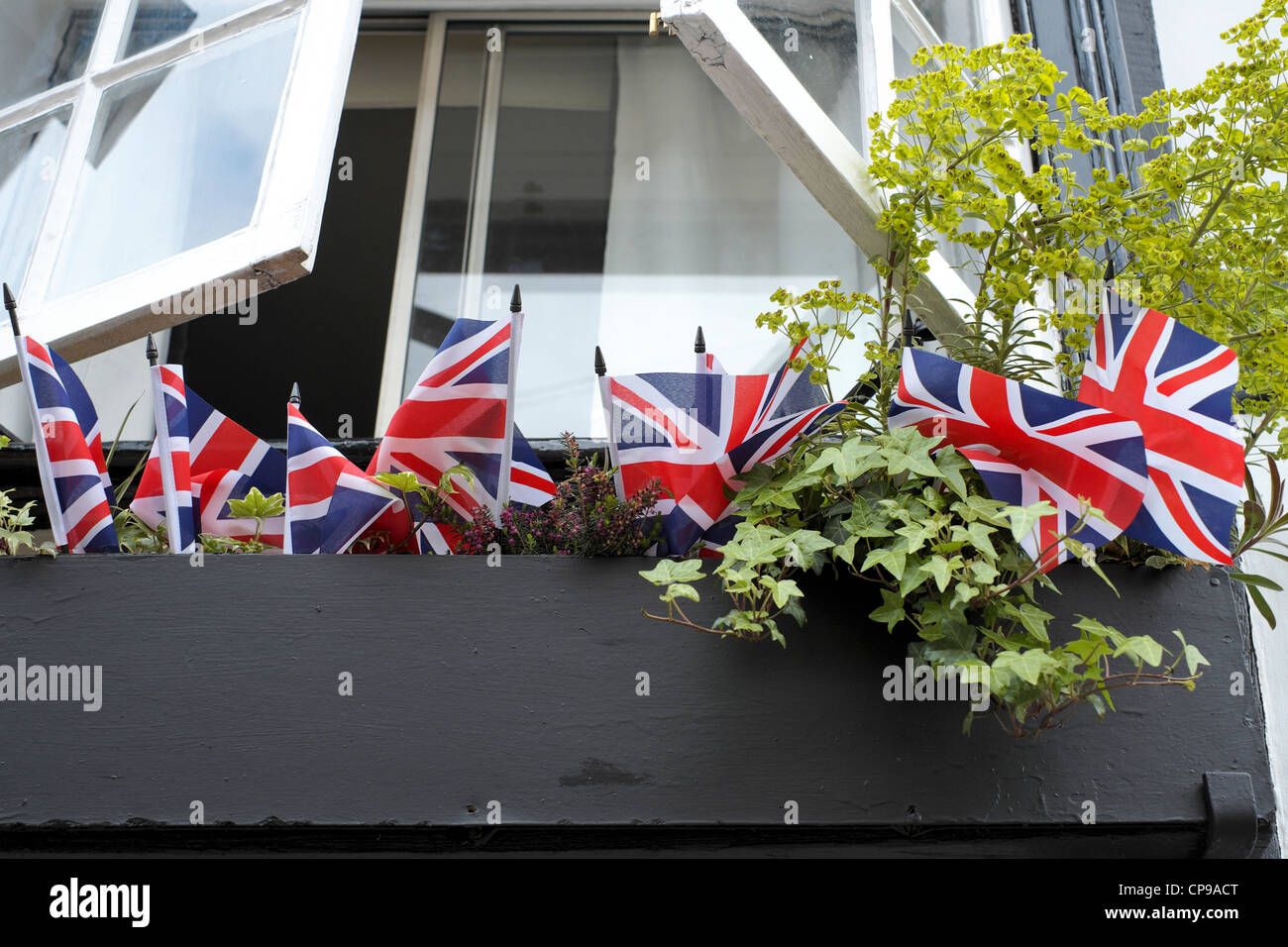 Small Union Jack British flags in a window box - Stock Image