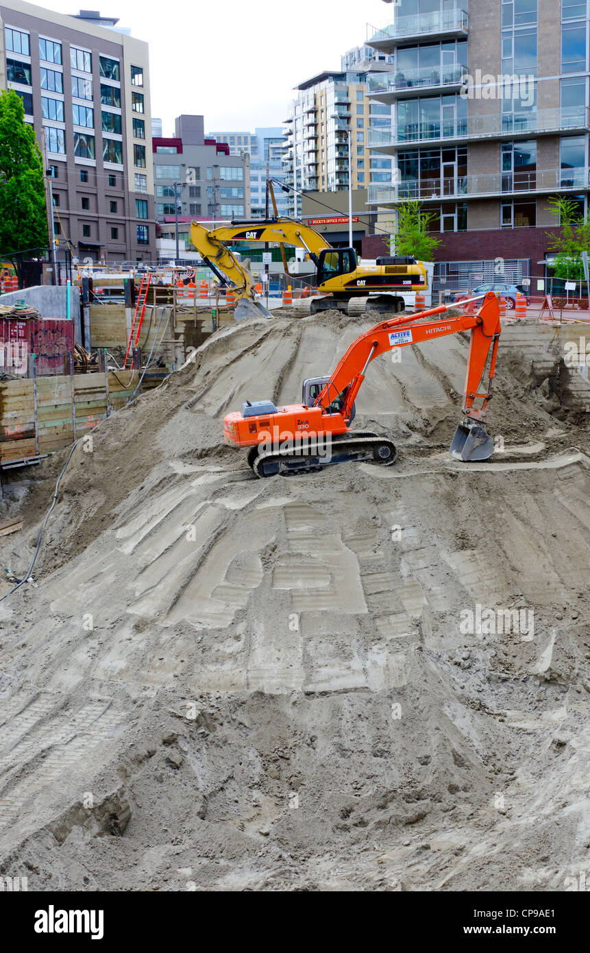 Huge construction hole being dugs for the foundation of a skyscraper in Seattle Wa, USA - Stock Image