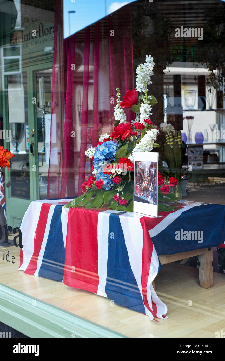 Red white and blue flower display with a union jack flag in a flower red white and blue flower display with a union jack flag in a flower shop window to mark the queens diamond jubilee celebrations mightylinksfo