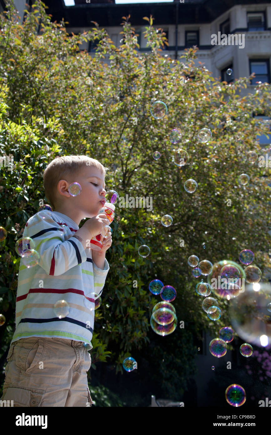 Young Boy Blowing Bubbles - Stock Image