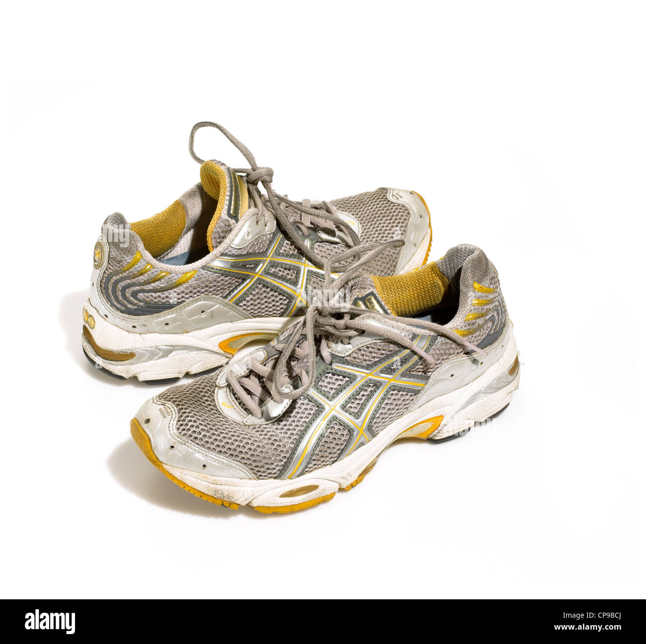 Worn-in Athletic Running Sneakers - Stock Image