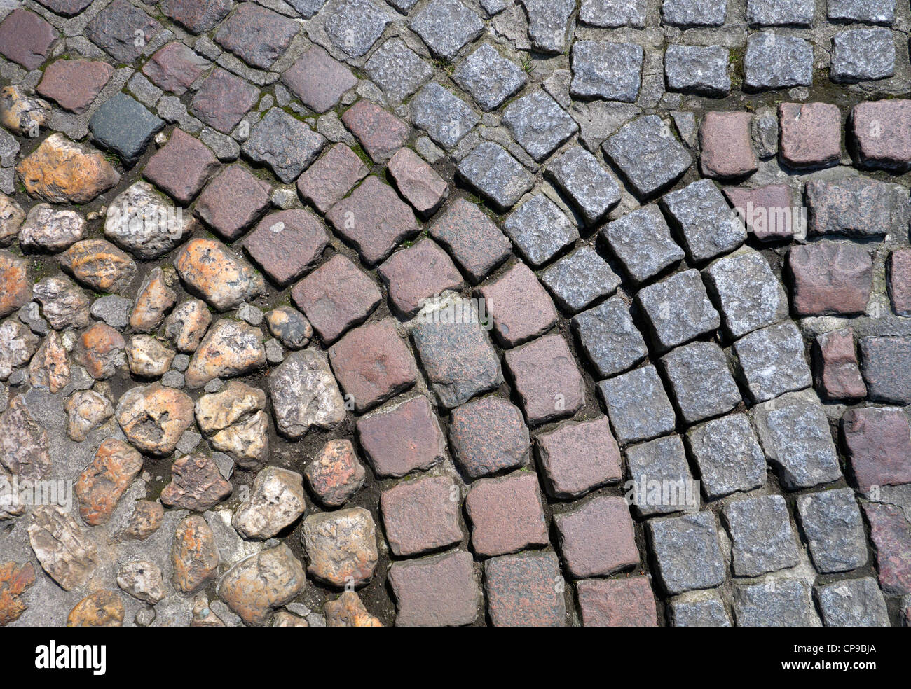 Different types of old and new cobblestones in Truro, Cornwall UK - Stock Image