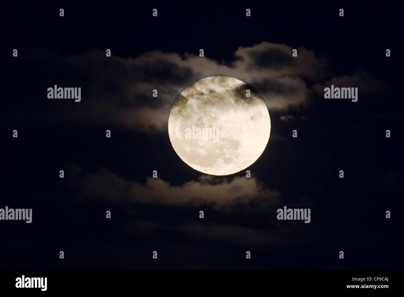 Perigree full moon, or supermoon, rises over Salida, Colorado, USA. Moon is closer to earth in orbit than normal. Stock Photo
