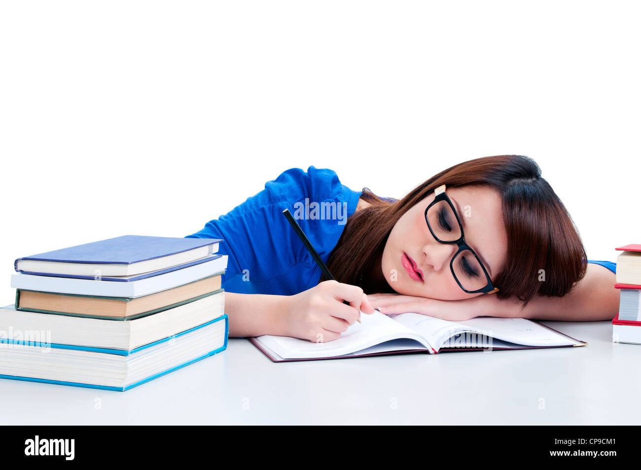 Beautiful young woman writing - Stock Image