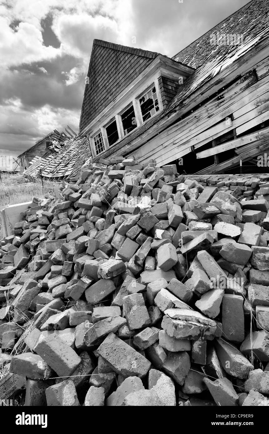 Pile of bricks in front of collapsed building, Hot Lake, Oregon. - Stock Image