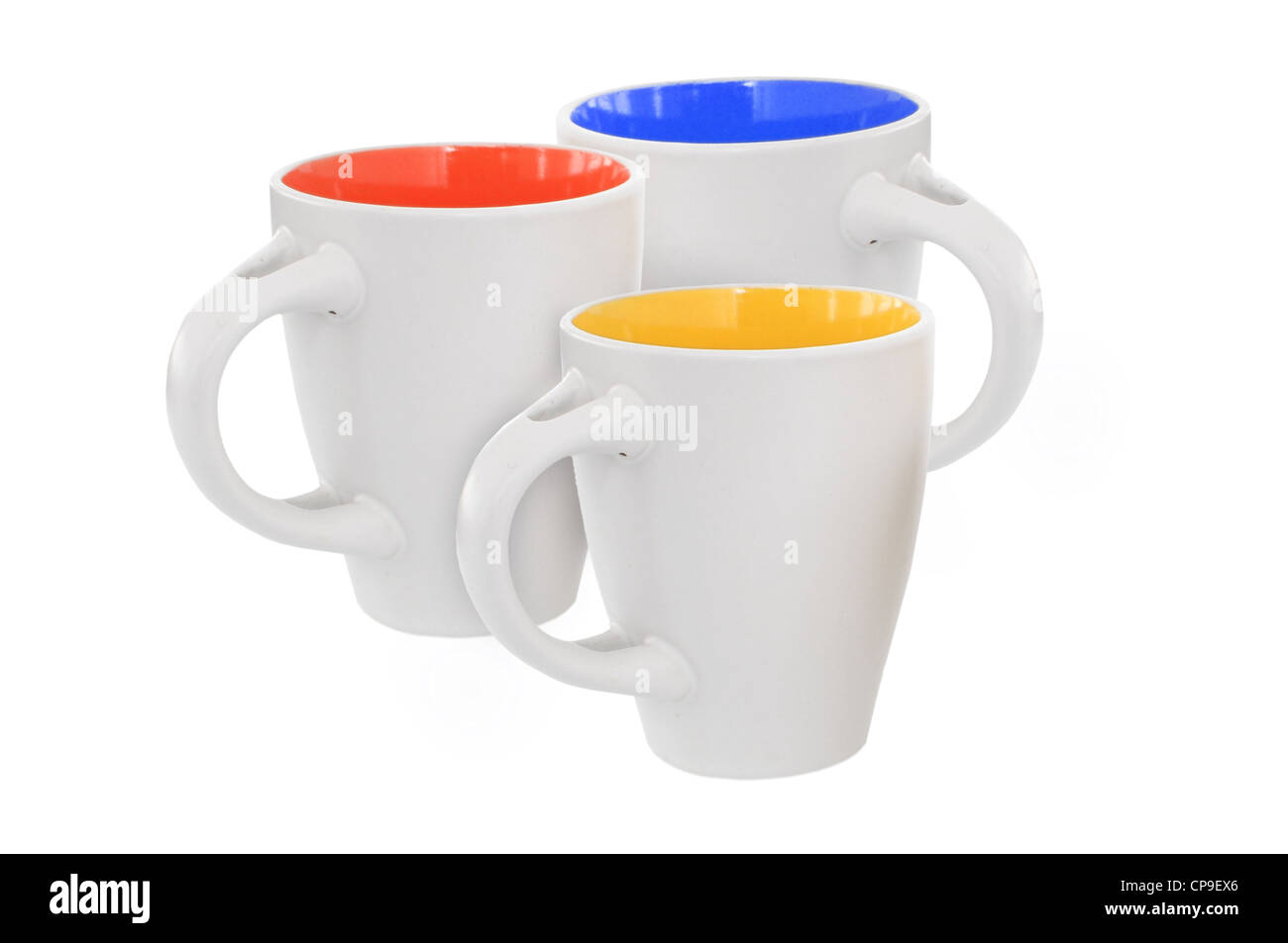 Three multicolored mugs, isolated on white - Stock Image