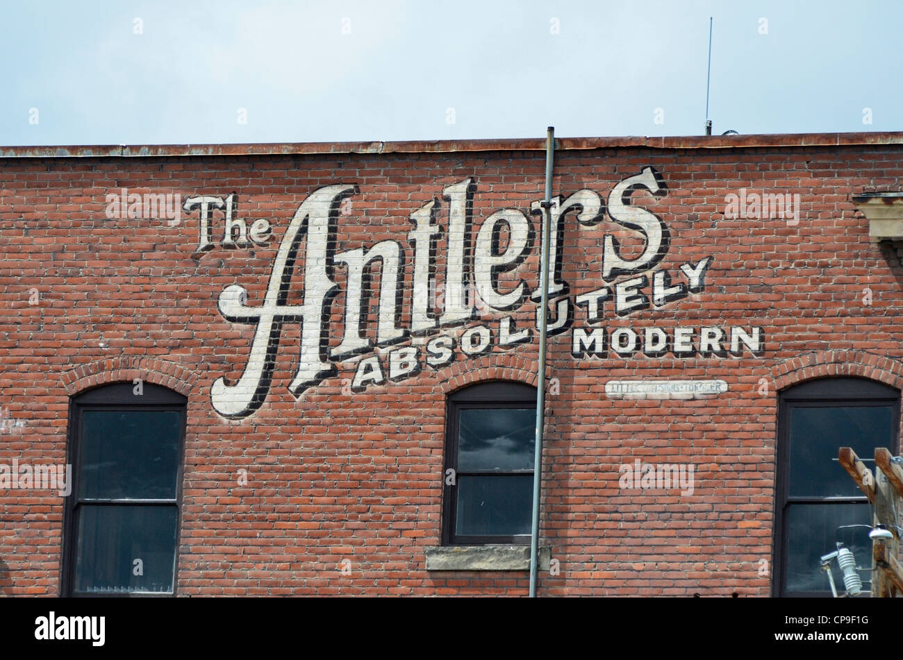 Old sign painted onto brick building in Baker City, Oregon. - Stock Image