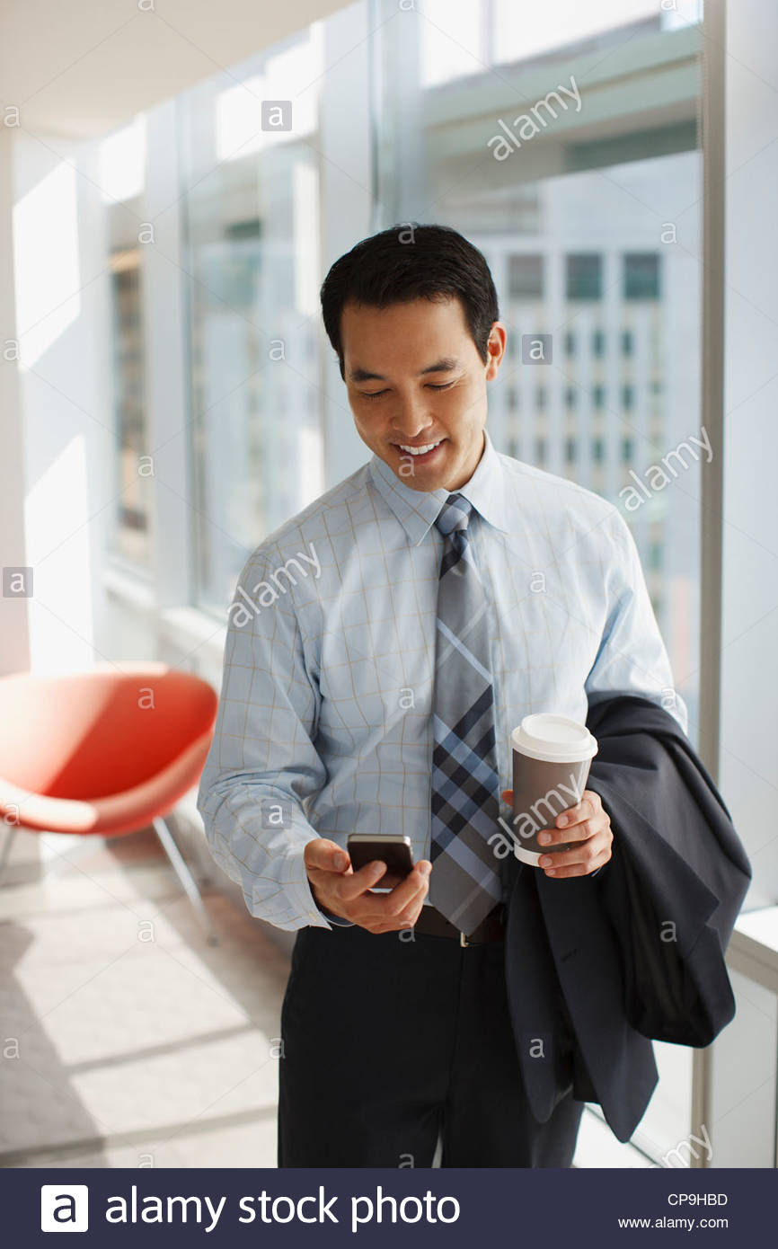 30-34 years,answering,asian ethnicity,black hair,business,business attire,businessman,california,carrying,cell - Stock Image