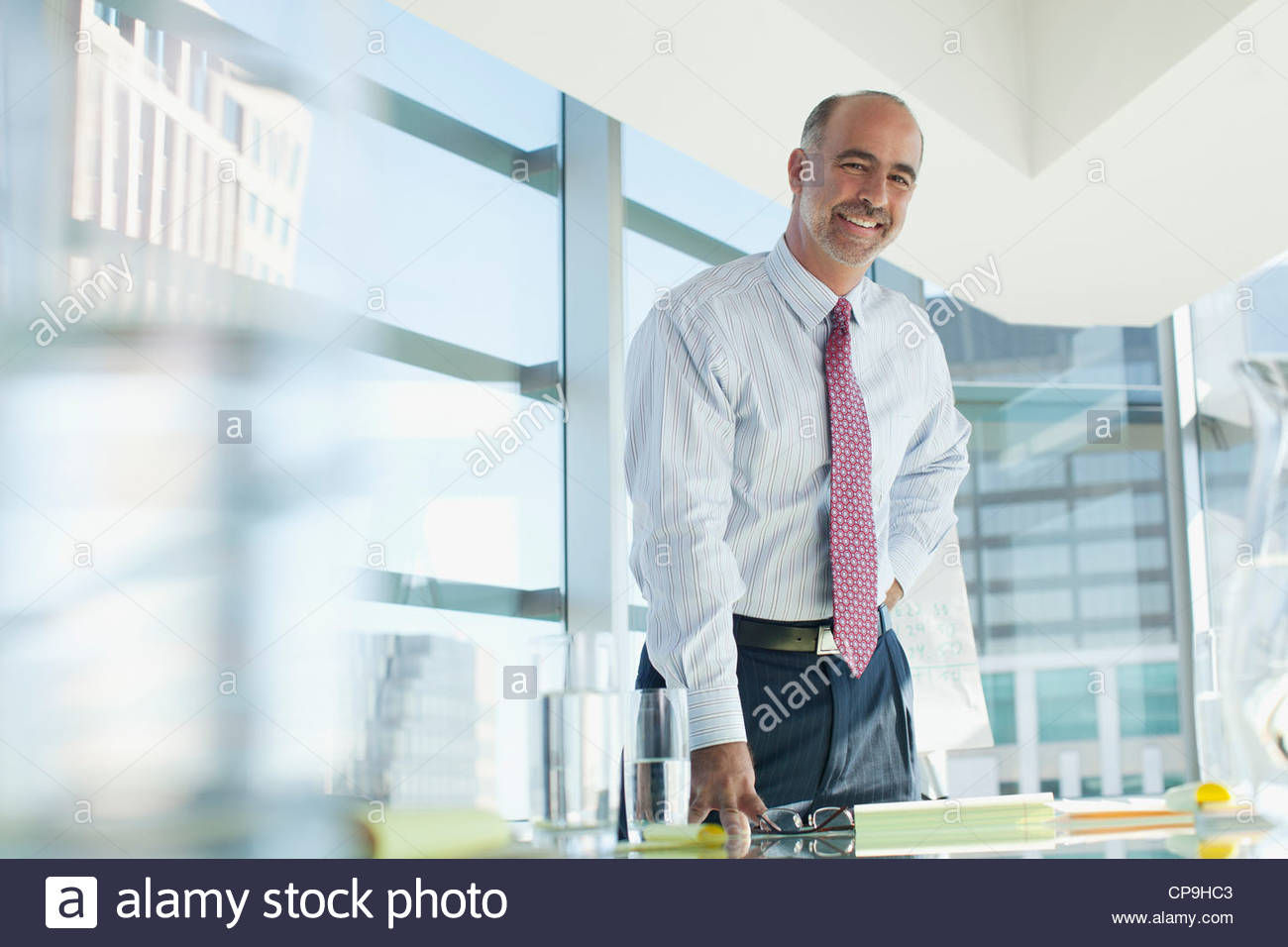 50-54 years,ambition,bald,business,business attire,businessman,california,color image,conference room,confidence,copy - Stock Image