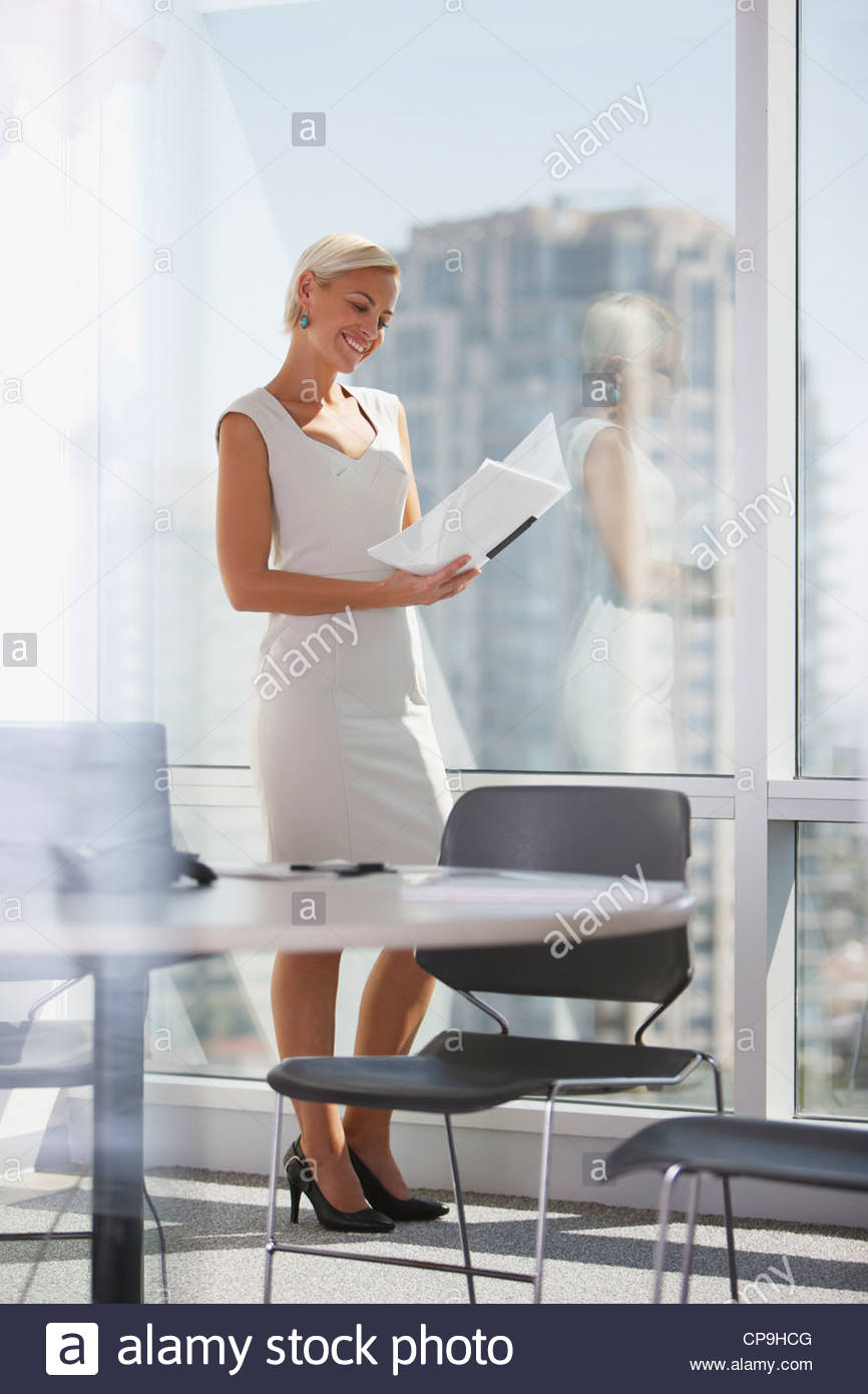 30-34 years,ambition,binder,business,business attire,businesswoman,california,caucasian,chair,checking,color image,conference - Stock Image