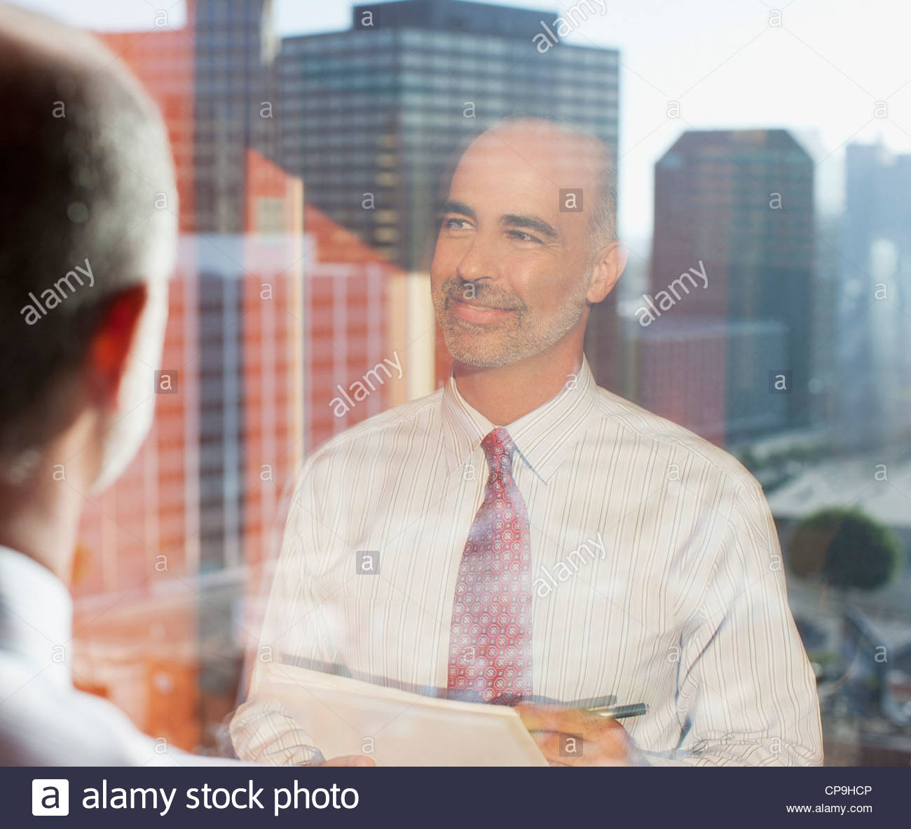 50-54 years,ambition,bald,business,business attire,businessman,california,city life,color image,day,happiness,head - Stock Image
