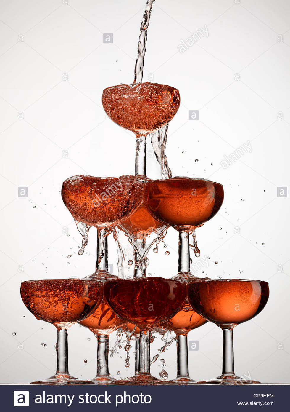 abundance,bubble,celebration,champagne,champagne glass,color image,concept,energy,excess,exuberance,filling,food - Stock Image