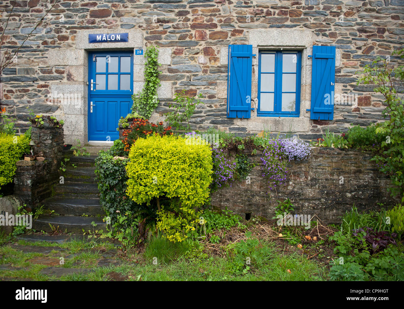 Traditional stone house of the lock keeper at Mâlon on the Vilaine river in Brittany, France - Stock Image