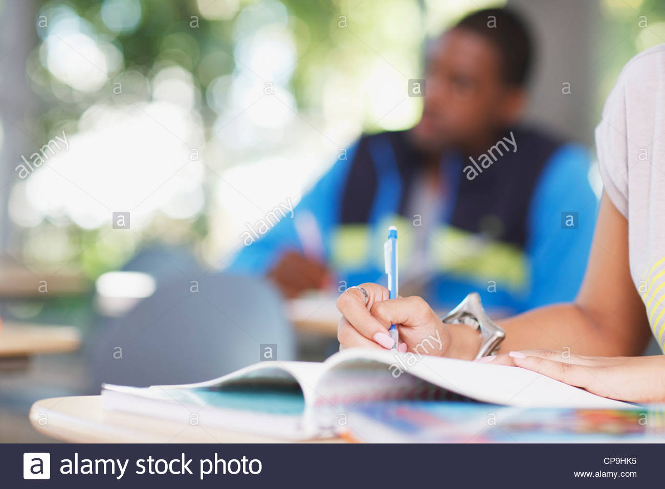 18-19 years,25-29 years,casual clothing,classmate,classroom,college,color image,copy space,day,education,focus on - Stock Image