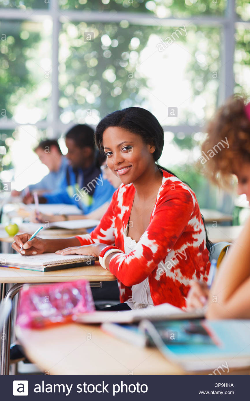 18-19 years,20-24 years,25-29 years,african ethnicity,casual clothing,caucasian,classmate,classroom,college,color - Stock Image