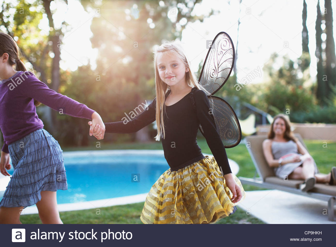 30-34 years,8-9 years,bonding,casual clothing,caucasian,childhood,color image,connection,costume,day,domestic life,elementary - Stock Image