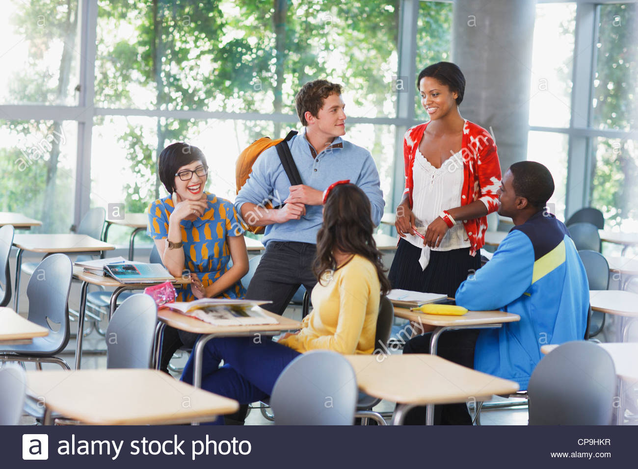 18-19 years,20-24 years,25-29 years,african ethnicity,asian ethnicity,casual - Stock Image