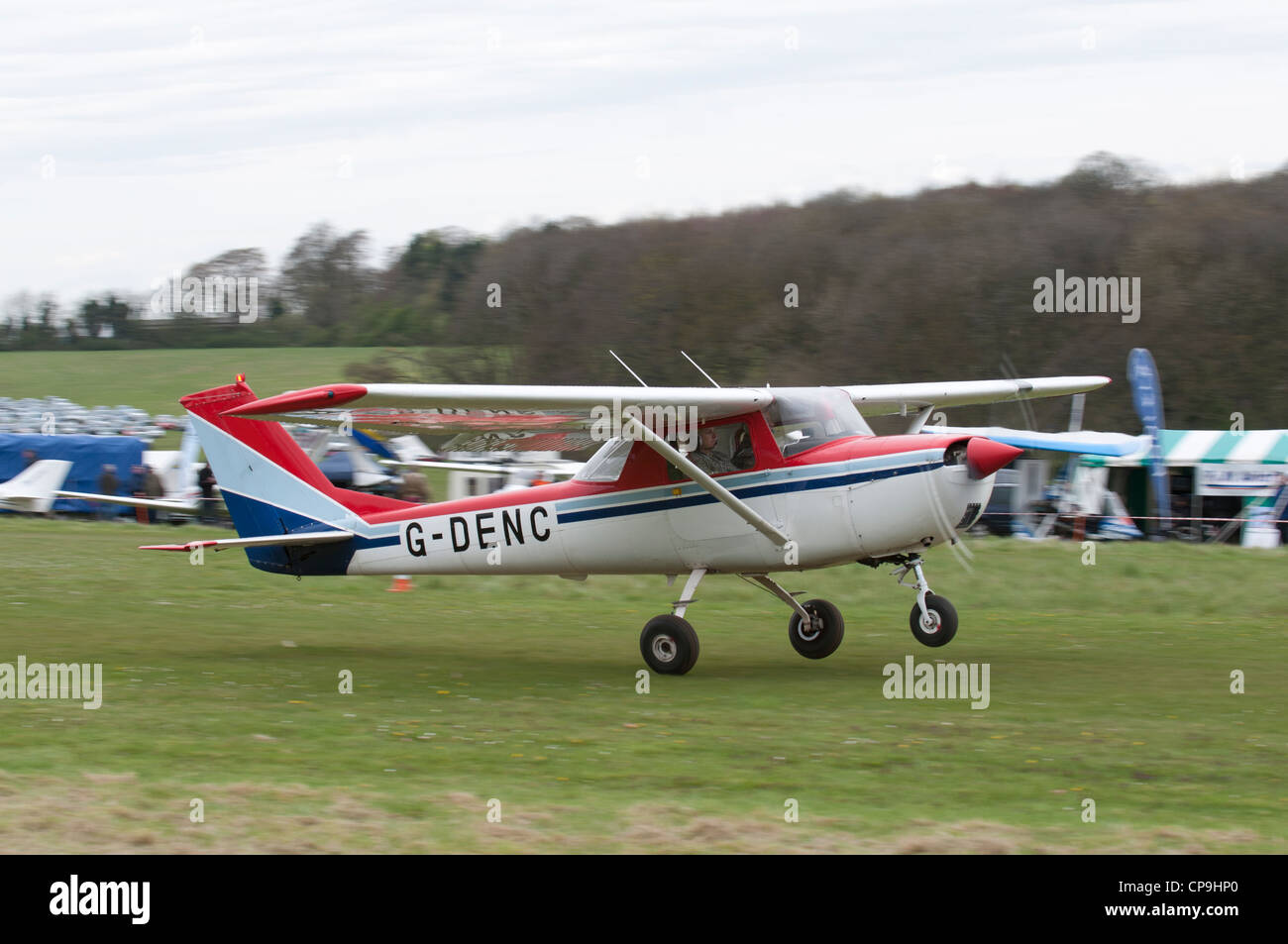 Reims Aviation Cessna 150 Registration G-DENC takes off from Popham airfield near Basingstoke Hampshire England - Stock Image