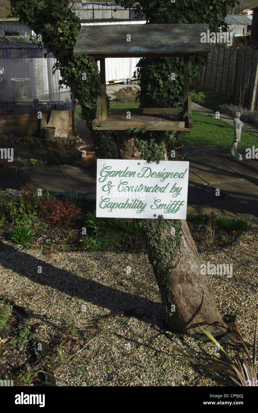 Quirky sign featuring garden design by Capability Smifff - Stock Image
