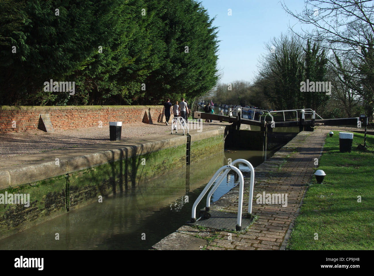 Enjoying an afternoon stroll by the canal at Cosgrove - Stock Image