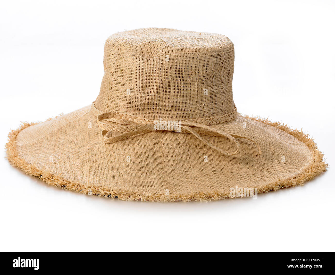 wide brimmed ladies linen look straw colored hat - Stock Image