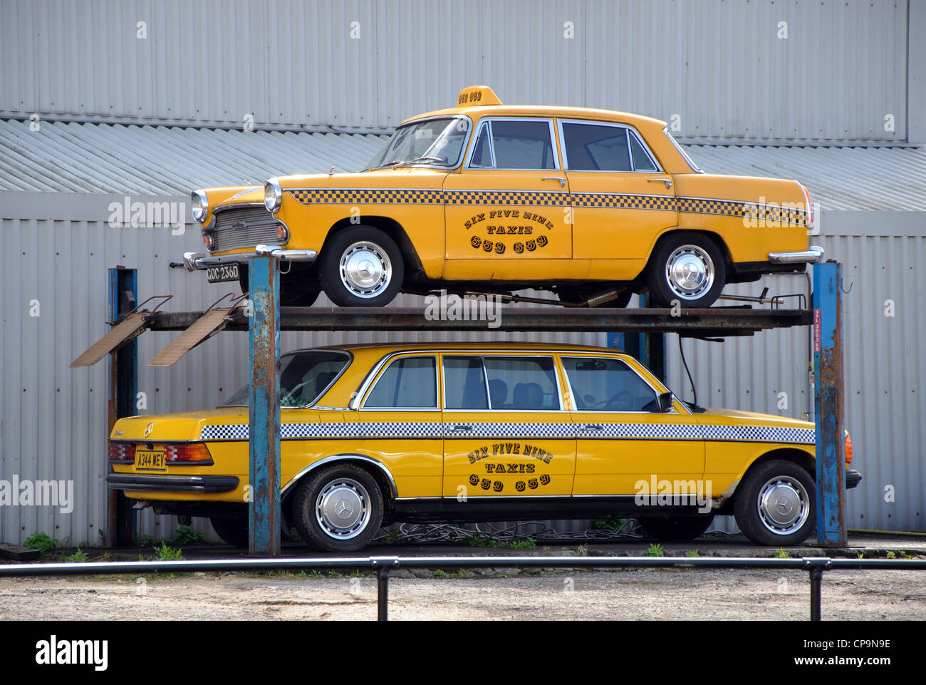 New York style yellow taxi cabs parked on ramp, York,England, UK - Stock Image