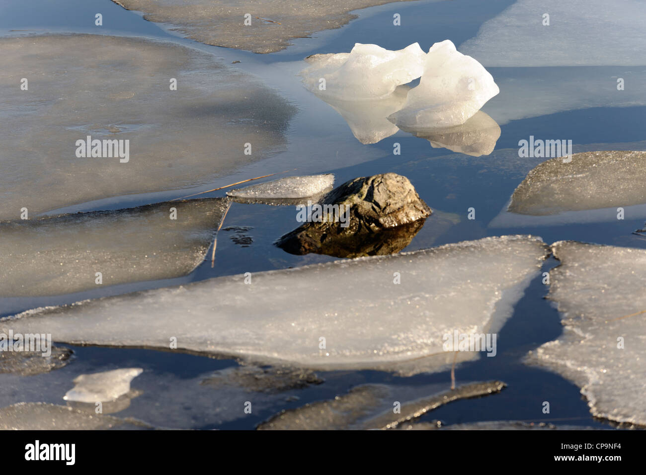 The ice is breaking on a spring day in the Stockholm archipelago - Stock Image