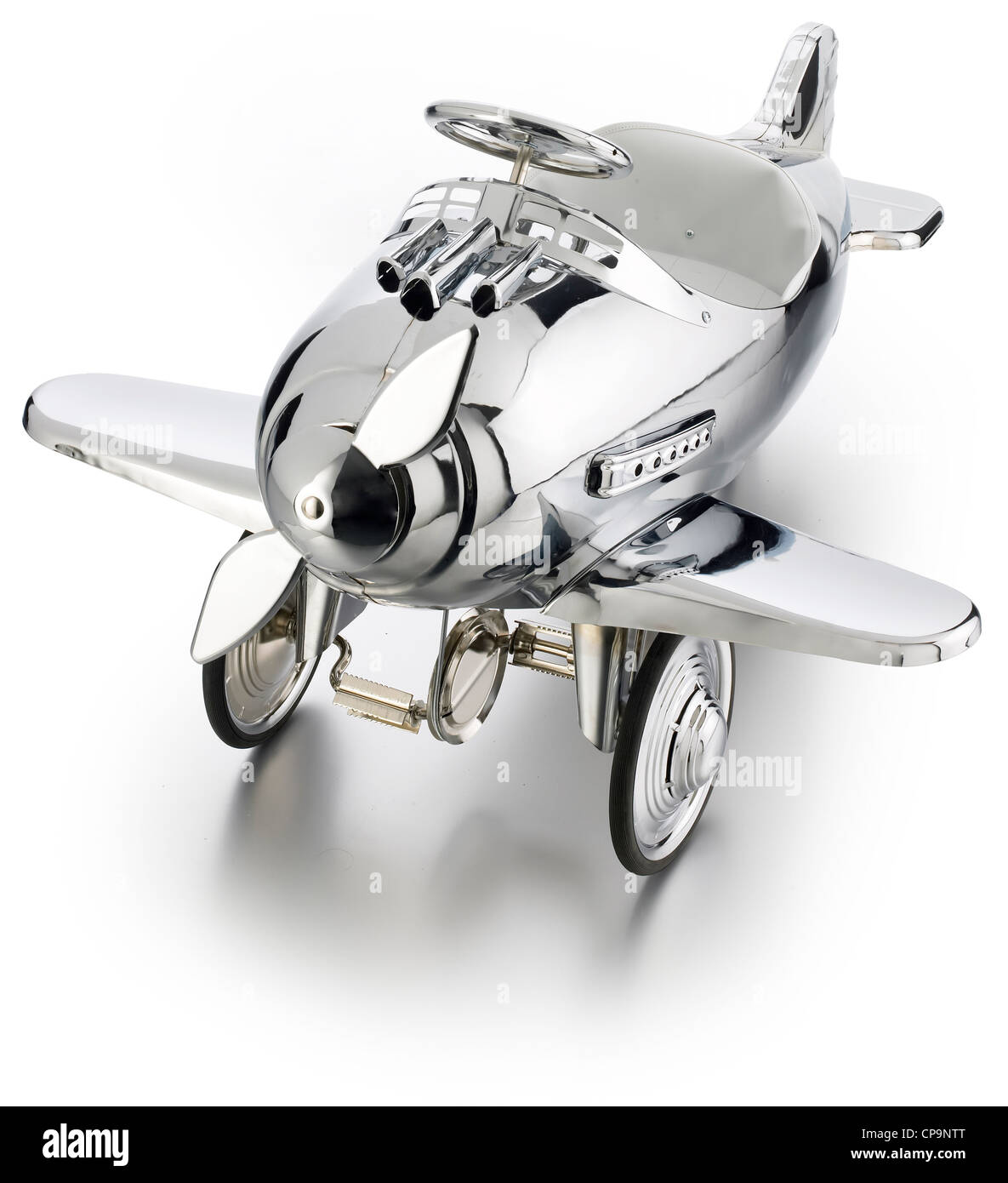 metal chrome shiny pedal toy airplane - Stock Image