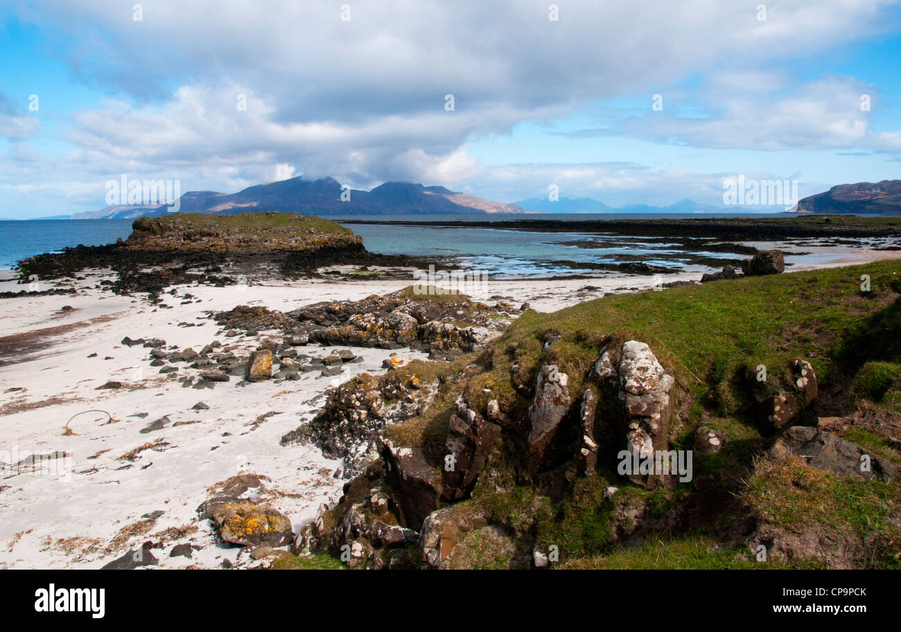 a landscape of galanach bay isle of muck with rum in the back ground off the west coast of scotland - Stock Image