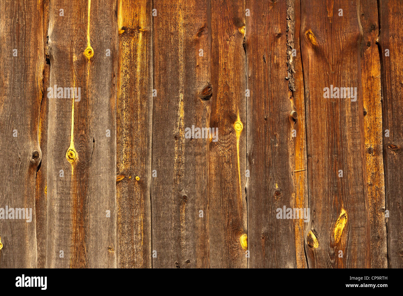 A fence made of wooden planks - Stock Image