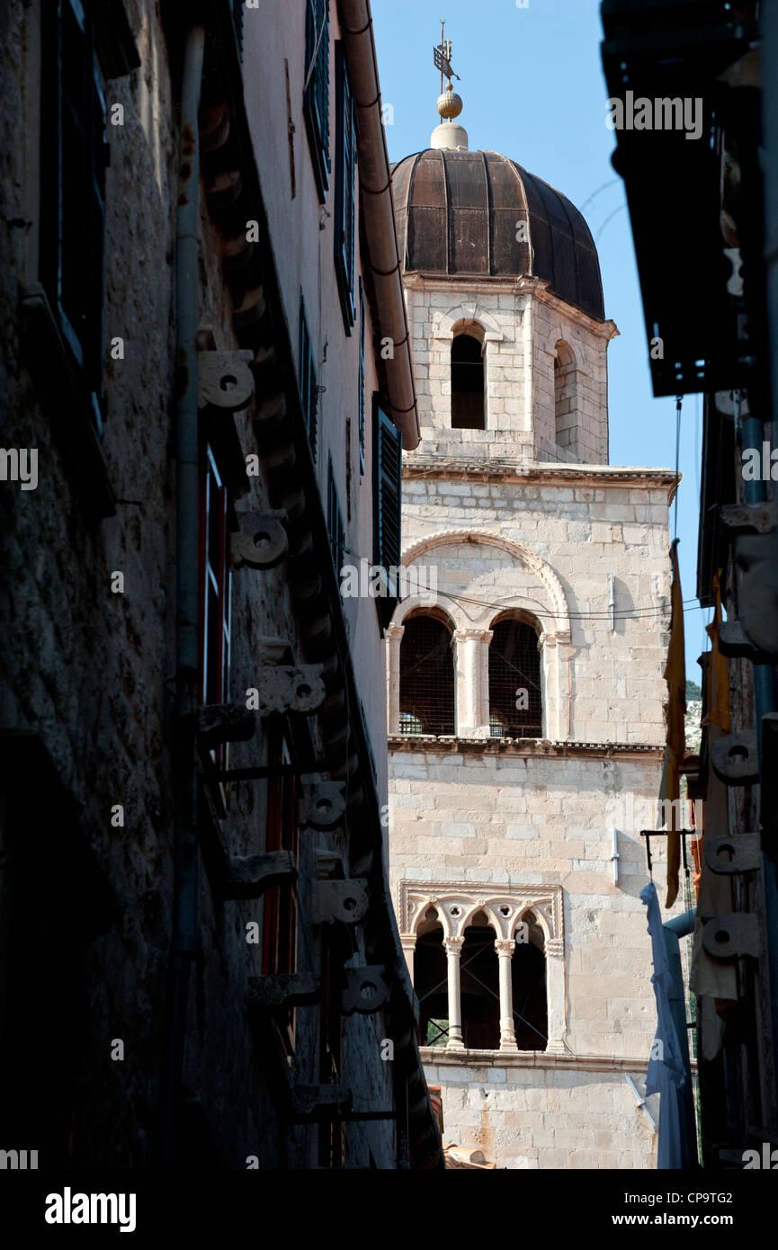 Belfry of the Franciscan Monastery at main boulevard Stadrun , Old Town, Dubrovnik. Croatia. - Stock Image