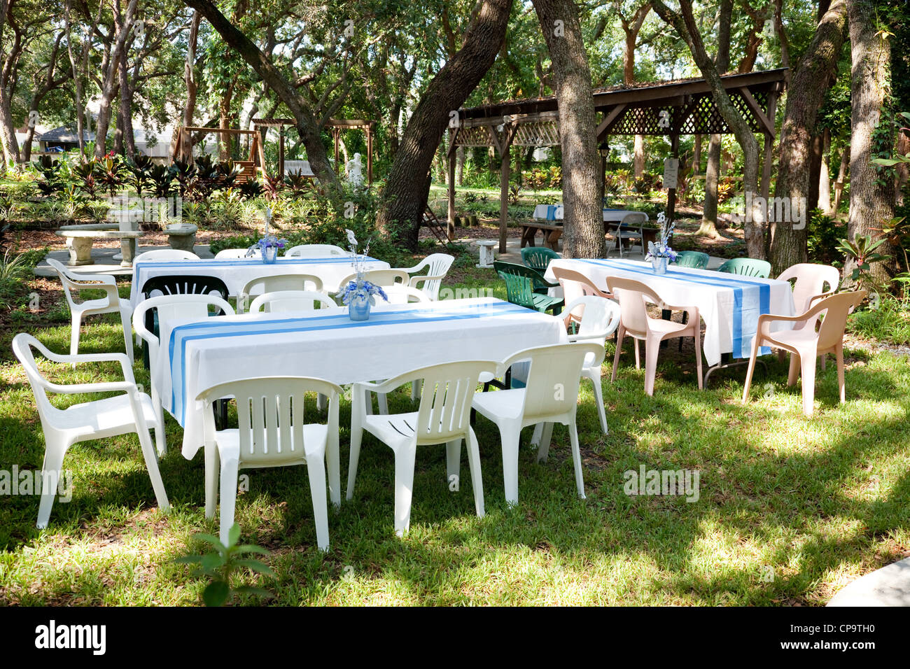 Tables and chairs set up for a garden party, wedding, or other