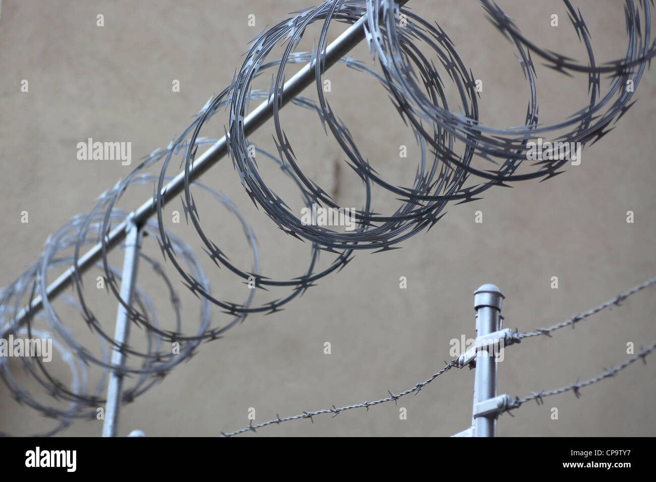 Razor wire above barbed wire fence Stock Photo: 48160315 - Alamy