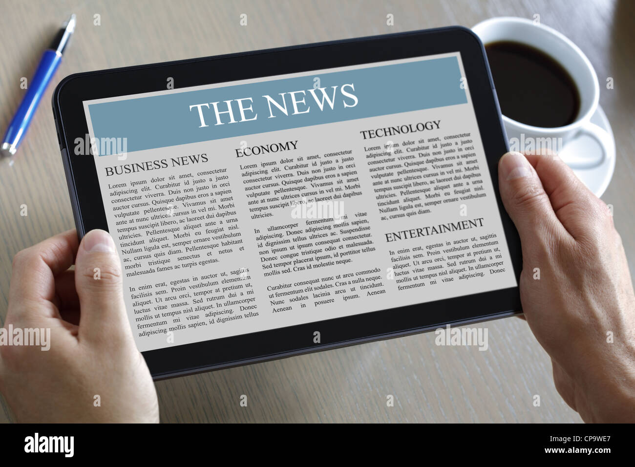 Digital tablet showing news - Stock Image