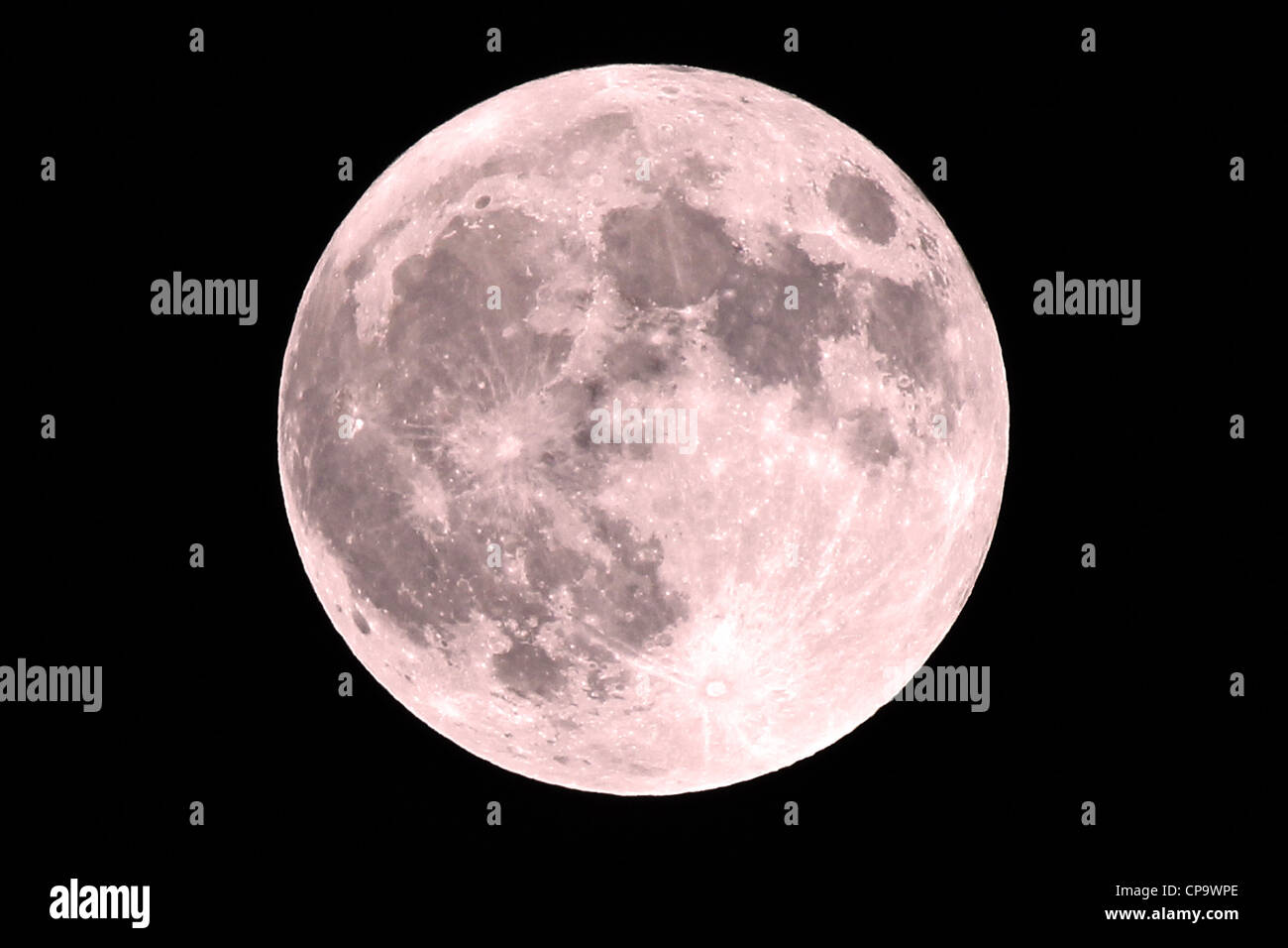 Red Super Moon at 100% full, taken at its perigee on 5 May 2012. A Super Moon occurs when a full moon is at its - Stock Image