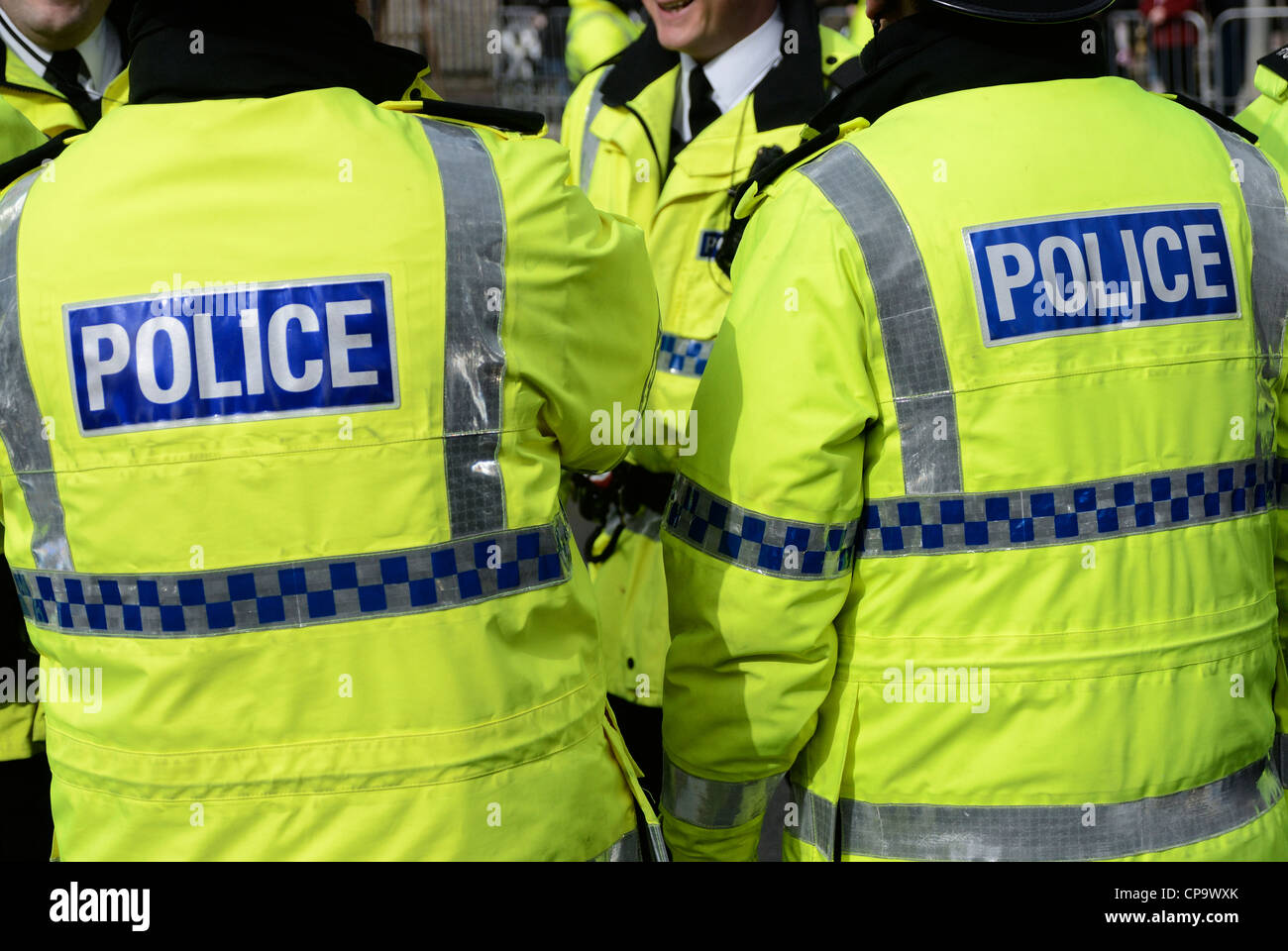 Police in fluorescent yellow jackets. Stock Photo