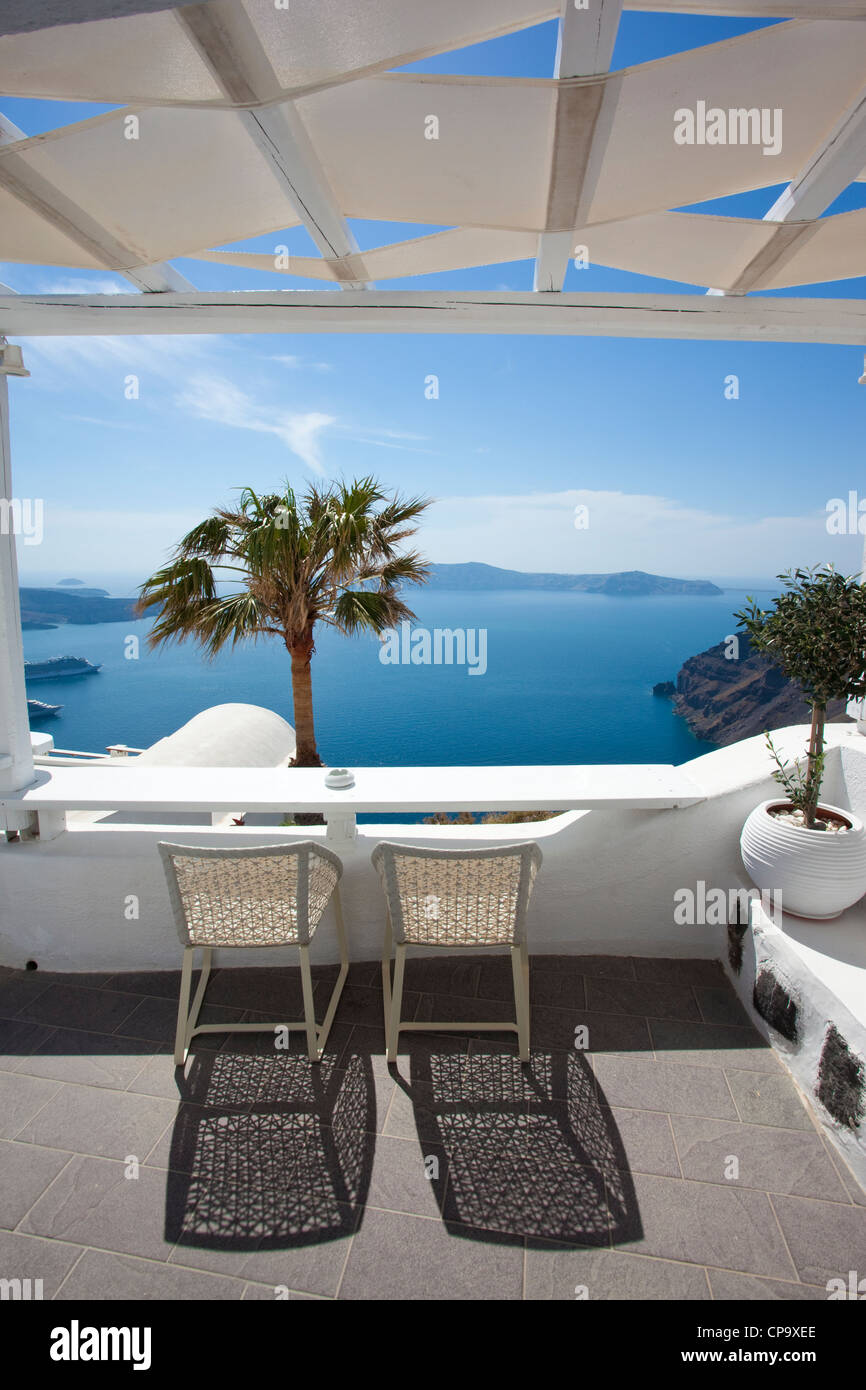 View over Millhouses studios looking out onto the Aegean Sea, Firostephani, Santorini, Cyclades, Greece - Stock Image
