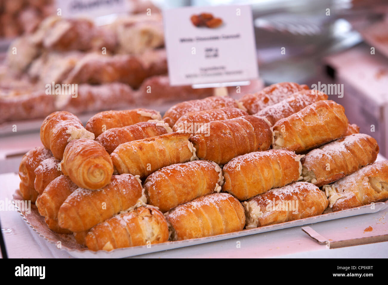 various italian cannoli desserts on sale at an italian food market in the uk - Stock Image