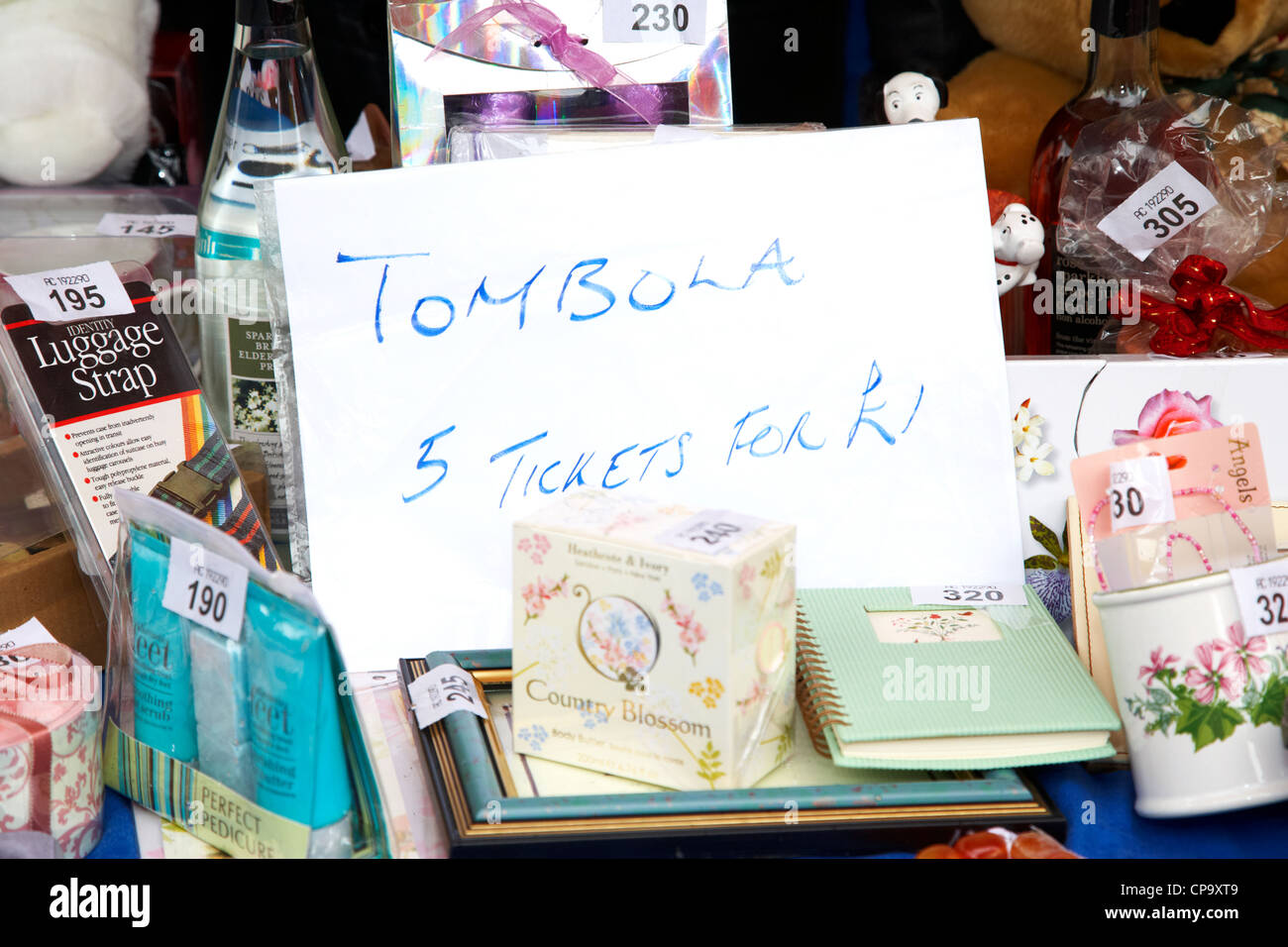 sign for a tombola raffle tickets on a charity shop stall in the uk