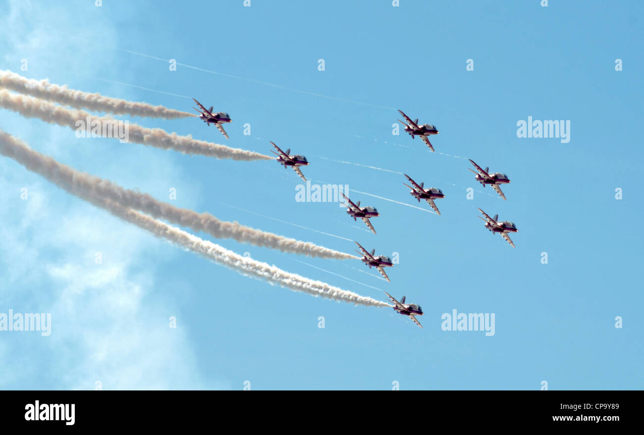 Hawk T Red Arrow jets from the British Air Force perform aerobatics and mid air stunts on July 23, 2011 in Southport, - Stock Image